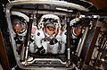 The three members of the American ASTP prime crew are photographed inside the Apollo Command Module trainer.jpg