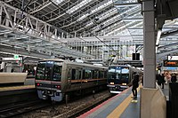 Tokaido Main Line local trains at Osaka Station.jpg