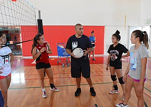 Nile C. Kinnick High School - Tony San Nicoles, center, varsity head volleyball coach for the Red Devils of Nile C. Kinnick High School, discusses offensive and defensive tactics with players during practice in the Nile C. Kinnick gym August 27, 2013.