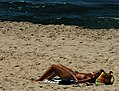 Topless woman sunbathing, Aveiro, Portugal.jpg