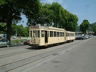 Heritage streetcar - ASVi museum line. Standard type tram 10308 with Brabant type trailer 19220 in the city of Thuin.