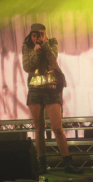Tulisa - Tulisa during a concert with the band in Pilton, the United Kingdom during June 2010.