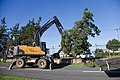 U.S. Airmen assigned to the 374th Civil Engineer Squadron use heavy equipment to clear fallen trees during clean up operations following Typhoon Roke at Yokota Air Base, Japan, Sept 110922-F-PM645-001.jpg