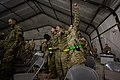 U.S. Airmen with the 455th Expeditionary Maintenance Group sing along during a U.S. Air Forces Central Command Band performance at Bagram Airfield, Afghanistan, Dec. 21, 2013 131221-F-XT249-223.jpg