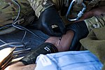 U.S. Army Spc. Ryan Waller, a flight medic with Charlie Company, 1st Battalion, 168th Aviation Regiment, inserts an intravenous line into a wounded Afghan soldier's arm aboard a UH-60 Black Hawk helicopter while 131114-M-ZB219-031.jpg
