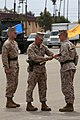 U.S. Marine Corps Sgt. Maj. Scott T. Pile, outgoing sergeant major 11th Marine Expeditionary Unit, hands over a noncommissioned officer sword signifying his end of tour as the acting sergeant major of the 11th 130516-M-BZ222-006.jpg