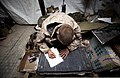 U.S. Marine Lance Cpl. Devin Deweerdt, a mortarman with 3rd Platoon, Kilo Company, 3rd Battalion, 3rd Marine Regiment, writes his wife a letter in his sleeping area after a day of work at Patrol Base Bury, a 120226-M-MM918-008.jpg