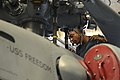 U.S. Navy Aviation Mechanic 2nd Class Christopher Gamble, assigned to Helicopter Maritime Strike Squadron (HSM) 73, performs preventive maintenance on an MH-60R Seahawk helicopter aboard the littoral combat ship 130521-N-PD773-002.jpg