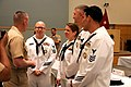 U.S. Navy Master Chief Petty Officer of the Navy Michael D. Stevens, left, speaks with Navy Counselor (NC) 1st Class Brian K. Gadeberg, NC1 Tori Novo, Culinary Specialist 1st Class Robert G. Wilder and NC1 130827-N-UT455-015.jpg