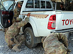 U.S. Soldiers with the 2nd Brigade Special Troops Battalion, 1st Cavalry Division search a vehicle during a training session led by Combined Joint Task Force Paladin at Bagram Airfield, Afghanistan, Aug. 7 130807-D-ZQ898-350.jpg