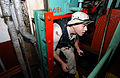 US Navy 021206-N-0331L-012 inspecting a small space on a Chinese vessel leaving Iraq.jpg