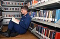 US Navy 030719-N-2805V-001 Ship's Serviceman 2nd Class Edwin York enjoys his free time in the library aboard USS Harry S. Truman (CVN 75).jpg