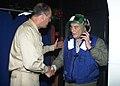 US Navy 030827-N-2954M-031 Capt. David Taylor, commander, Amphibious Squadron Six, greets Sen. John Warner (R-Va.), Chairman, Armed Services Committee, aboard the amphibious assault ship USS Iwo Jima (LHD 7).jpg