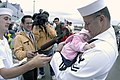 US Navy 030919-N-6477M-154 Disbursing Clerk 2nd Class Larry Pearlman assigned to the USS Ingraham (FFG 61) meets his new three week old daughter upon returning from deployment.jpg