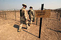 US Navy 031015-N-3236B-010 Marines assigned to 13th Marine Expeditionary Unit (MEU) and Expeditionary Strike Group One (ESG-1) construct a detainee camp used to hold oil smugglers near Al Faw, Iraq during Operation Iraqi Freedo.jpg