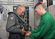 US Navy 031127-N-4669B-001 British Major General Graeme Lamb is fitted for his flight suit by Aircrew Survival Equipmentman 2nd Class Jeffery D. Schmidt.jpg