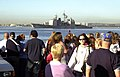 US Navy 040111-N-3874J-005 Family and friends wait on the pier as the guided missile cruiser USS Lake Champlain (CG 57) sails into the San Diego Harbor.jpg