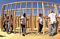 US Navy 040623-N-8977L-010 Sailors assigned to Nimitz-class aircraft carrier USS Ronald Reagan (CVN 76) position a frame of a wall while helping the non-profit group Habitat for Humanity build homes.jpg