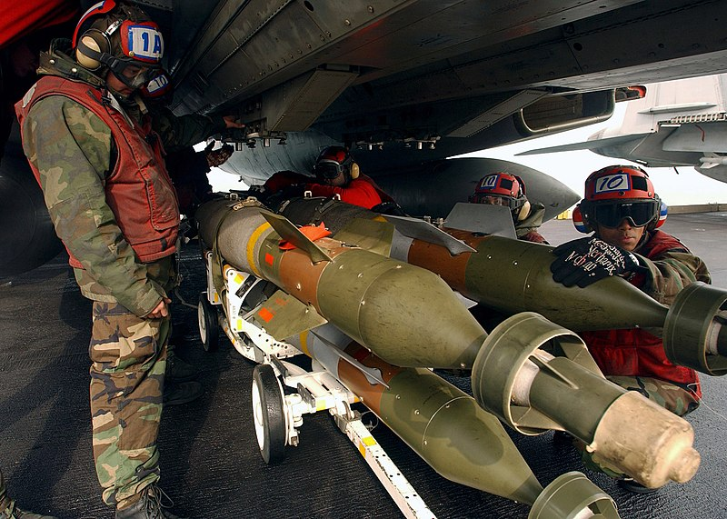 US Navy 050112-N-5345W-074 Aviation Ordnancemen prepare to load 500-pound laser guided bombs (GBU-12) onto weapon pylons under an F-14B Tomcat.jpg