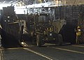 US Navy 050126-2651J-N-001 Sailors assigned to Naval Mobile Construction Battalion One (NMCB-1) transfer equipment from the Landing Craft Utility (LCU) 1655 to the well deck of the Amphibious Assault ship USS Saipan (LHA 2).jpg