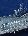 "US Navy 050419-N-4004O-001 Crewmembers aboard the Nimitz-class aircraft carrier USS Dwight D. Eisenhower (CVN 69) spell out ""IKE IS BACK"" on the ship's flight deck.jpg"