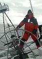 US Navy 050816-N-6775N-126 Hull Technician 1st Class Rick Pellton mans the helm while on watch aboard the sailboat, Coruba.jpg
