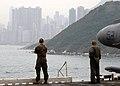 US Navy 060125-N-2256V-002 Marines aboard the amphibious assault ship USS Tarawa (LHA 1) observes the sites of Hong Kong, as the ship prepares to make a port call.jpg