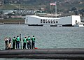 US Navy 060210-N-3019M-006 Sailors stationed aboard the Los Angeles-class fast attack submarine USS Louisville (SSN 724) watch as the submarine pass the USS Arizona Memorial.jpg
