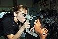 US Navy 060530-N-8391L-153 U.S. Air Force Capt. Jennifer Owen administers an eye exam during a Medical-Dental Civil Action Program (MEDCAP) held by the Military Sealift Command (MSC) Hospital ship USNS Mercy (T-AH 19).jpg