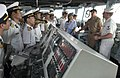 US Navy 060704-N-9851B-003 Quartermaster 3rd Class Robert Arredondo, explains to visitors from the Navy division of the People's Army of Vietnam (PAVN) how rescue and salvage ship USS Salvor (ARS 52) is controlled from the brid.jpg