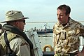 US Navy 070308-N-0448N-058 Royal navy Lt. Cmdr Toby Ellison, Combined Task Group 158.1 future operations and training officer, speaks with a Coast Guard boarding team member during Exercise Rapid Talon.jpg