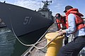 US Navy 070320-N-5253W-001 Pierside line handlers release a forward mooring line from the bollards as the Oliver Hazard Perry-class guided missile frigate USS Gary (FFG 51) gets underway on board Commander Fleet Activities Yoko.jpg