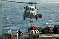 US Navy 070514-N-9760Z-015 An SH-60 Seahawk helicopter assigned to the Indians of Helicopter Antisubmarine Squadron (HS) 6 prepares to lift cargo during a vertical replenishment.jpg