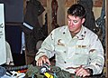 US Navy 070615-N-9204H-001 Aircrew Survival Equipmentman 3rd Class Justin McColl, a member of the Garudas of Electronic Attack Squadron (VAQ) 134, makes adjustments to an aircrew vest in the parachute rigger shop.jpg