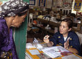 US Navy 070618-N-1467K-077 Chief Hospital Corpsman Joanna Miclat, attached to Naval Medical Center San Diego, explains the dosage of a prescribed medication to a Filipino woman during a medical civil assistance program (MEDCAP).jpg