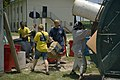 US Navy 070620-N-5319A-001 Members of High Speed Vessel (HSV) 2 Swift throw away trash while making repairs and helping cleaning up an orphanage in Belize. Task Group 40.9 is deployed as part of the pilot Global Fleet Station (.jpg
