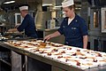 US Navy 070728-N-7088A-017 Culinary Specialist Seaman James Monoski and Fire Controlman 3rd Class Chelsea McKillips prepare meals for patients and their escorts in the galley aboard the Military Sealift Command hospital ship US.jpg