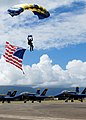 US Navy 071014-N-5476H-156 A member of the U.S. Navy Parachute Demonstration Team, the Leap Frogs, prepares for a patriotic landing during the Blues on the Bay Air Show at Marine Corps Base Hawaii.jpg