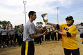 US Navy 071201-N-5328N-591 Army Capt. Bryan Hamilton receives the Center for Information Dominance (CID) Corry Station Flag Football Trophy from CID Commanding Officer Capt. Connie Frizzell following Army's 7-6 win over Navy at.jpg