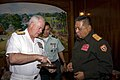 US Navy 071214-N-8623G-083 Adm. Timothy J. Keating, commander, U.S. Pacific Command, presents a plaque to, Major General Somphet Thipmala, Loa vice minister of National Defense.jpg