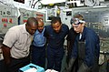 US Navy 080703-N-8943B-004 Gas Systems Turbine (Mechanical) Fireman James Smith explains an engineering system to members of the St. Lucia Marine Police.jpg