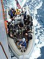 US Navy 080819-N-4431B-707 Seaman Francheska K. Montoya lifts the line holding a rigid hull inflatable boat.jpg
