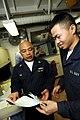 US Navy 081031-N-7280V-083 Machinist's Mate Fireman Zhicai Lu gets his new Navy Cash card.jpg