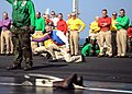US Navy 081201-N-7571S-003 Sailors gather to support former air boss, Capt. Carl Conti as he launches his boots off the ship's flight deck.jpg