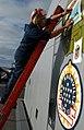 US Navy 090202-N-1688B-065 Aviation Boatswain's Mate Handling 3rd Class Juan Garza finishes a mural for Africa Partnership Station 2009 aboard USS Nashville (LPD 13).jpg