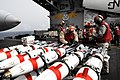 US Navy 090316-N-6046S-005 Aviation Ordnancemen inspect MK-62 mines on the flight deck of the aircraft carrier USS John C. Stennis (CVN 74) in preparation for loading onto aircraft as part of Exercise Foal Eagle 2009.jpg