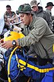 US Navy 090329-N-5242D-065 Senior Chief Navy Diver Jorge Guillen, assigned to Mobile Diving and Salvage Unit 2, secures a diver's underwater breathing apparatus before a dive into Africa's Lake Victoria.jpg
