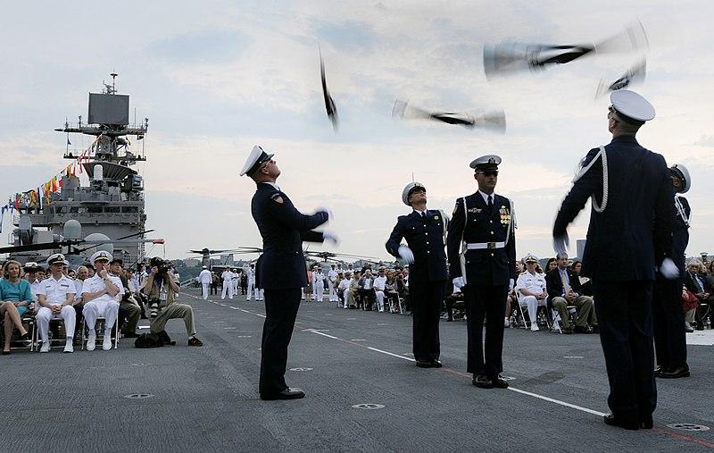 The U.S. Coast Guard Silent Drill Team performs during a Sunset Parade aboard the amphibious assault ship USS Iwo Jima (LHD 3) as part of Fleet Week New York City 2009.