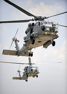 US Navy 090610-N-0413R-153 Two multi-mission MH-60R Sea Hawk helicopters fly in tandem during section landings at Naval Air Station Jacksonville, Fla.jpg