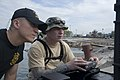 US Navy 100119-N-1134L-035 Capt. Scott Sann, commander of the 544th Engineer Dive Team, left, and Army diver Staff Sgt. William D'Angelo operate a remotely operated vehicle.jpg